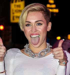 Barely a month after their divorce, Miley Cyrus is already living with their new girlfriend