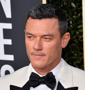 PHOTOS: Luke Evans and his 'tiny speedo' are giving Twitter heart palpitations