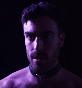 WATCH: Mike Taveira wears a singlet and gets slapped with a leather crop to satisfy his curiosities