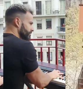 WATCH: Bearded Spaniard and mystery saxophonist serenade neighborhood under lockdown