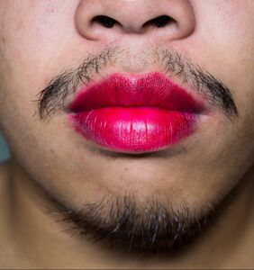 University employee says he was fired for wearing lipstick to work