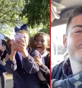 Schoolgirls squeal with sheer delight as they watch gay couple kiss in viral video