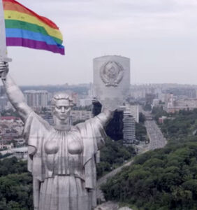 WATCH: LGBTQ activists use drone to place rainbow flag above city monument