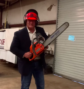 """Antigay lawmaker compares himself to """"Jews in Nazi Germany"""" as he chainsaws a mask in half"""
