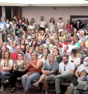 This video of 100+ mask-less protestors shouting in a cramped room will give you a panic attack