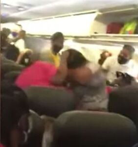 Fist fight breaks out on crowded airplane after passenger refuses to wear mask