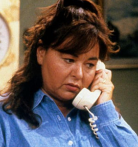 Roseanne accused of throwing phone at producer prior to being fired for racist outburst