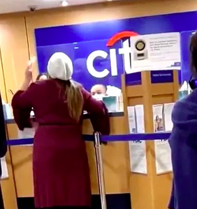 Karen, in her bathrobe, has meltdown inside bank, refuses to wear mask, claims to be a scientist