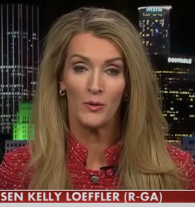 Kelly Loeffler says she's definitely not racist after being photographed with former KKK leader