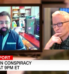 Ex-QAnon believer apologizes to Anderson Cooper for thinking he was a baby-eating robot