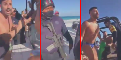 Gay couple arrested by officers with machine guns for kissing on the beach in Mexico