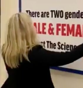 Marjorie Taylor Greene puts up anti-trans sign on Congress corridor wall
