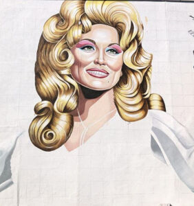 Screw the statue. The gays just ordered a giant mural of vaccine maven Dolly Parton.