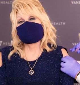 Dolly Parton gets Covid vaccine and tells people not to be  'cowards' about it
