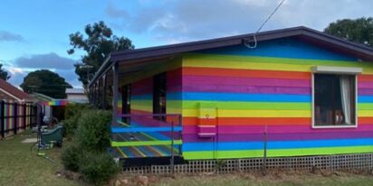 Neighbors help man paint his home in rainbows after he receives anti-gay abuse