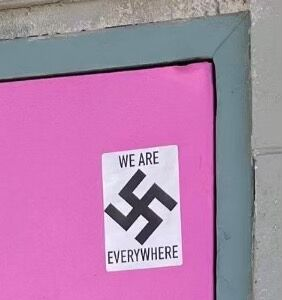 """Alaska gay bar marked with swastika sticker reading """"we are everywhere"""""""