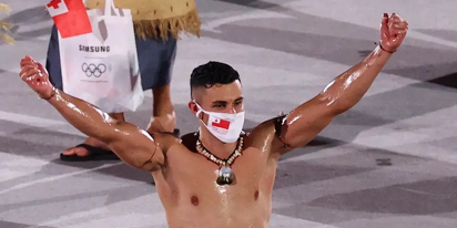 PHOTOS: Tongan flag bearer returns to Olympics, more oiled-up than ever