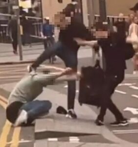 Gay couple pushed into oncoming traffic in horrifying attack